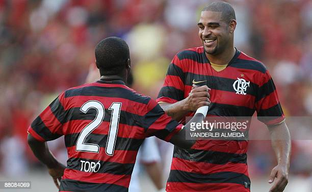 Brazilian striker Adriano of Flamengo celebrates his goal with Toro during their 2009 Brazil's Cup football match with Atletico Paranaense at...
