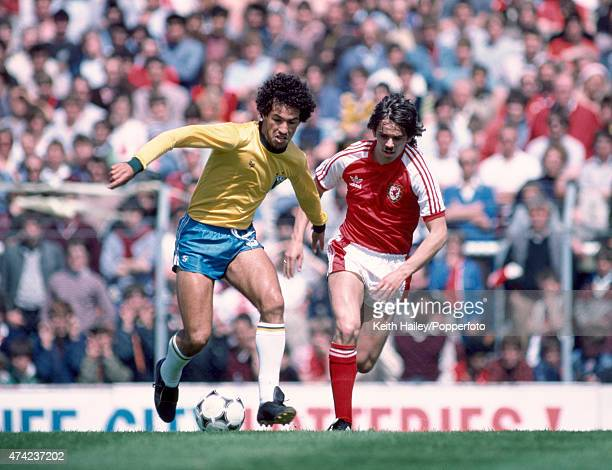 Brazilian striker Careca moves away from Wales' Alan Davies during the International friendly at Ninian Park in Cardiff 12th June 1983 The match...