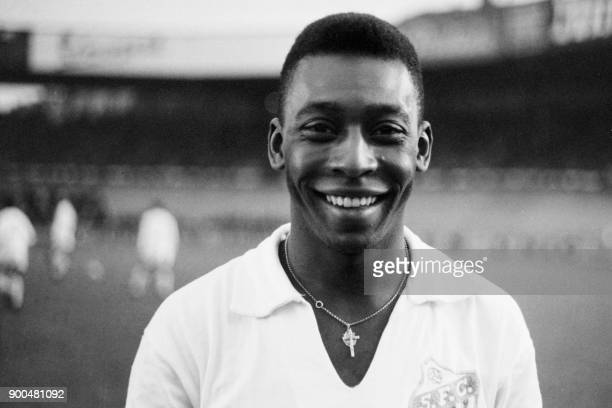 Brazilian striker Pelé wearing his Santos jersey smiles before playing a friendly soccer match with his club against the French club of Racing on...