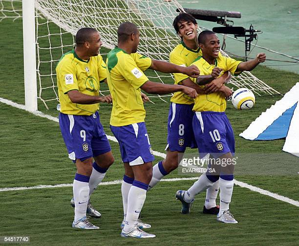 Brazilian striker Robinho celebrates with teammates Kaka Adriano and Ronaldo after scoring the second goal of their team against Chile during a match...
