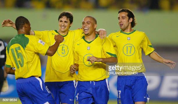 Brazilian striker Ronaldo celebrates his third goal from the penalty against Argentine with his teammates during a football match at the Mineirao...
