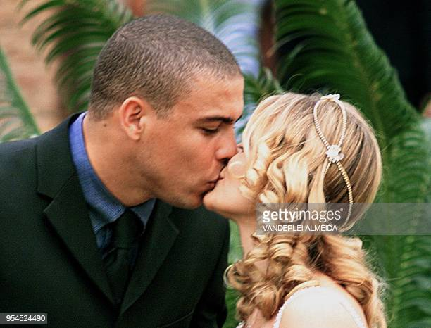 Brazilian striker Ronaldo kisses his bride, Milene Dominques, after their marriage 24 December 1999 in Rio de Janeiro. The 30-minute civil ceremony,...