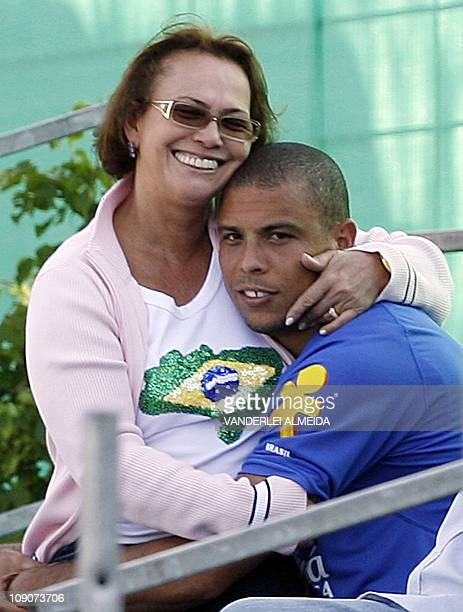 Brazilian striker Ronaldo Nazario is spoiled by his mother Sonia 10 June 2006, after a training session at the Zagallo Arena in Konigstein, Germany....