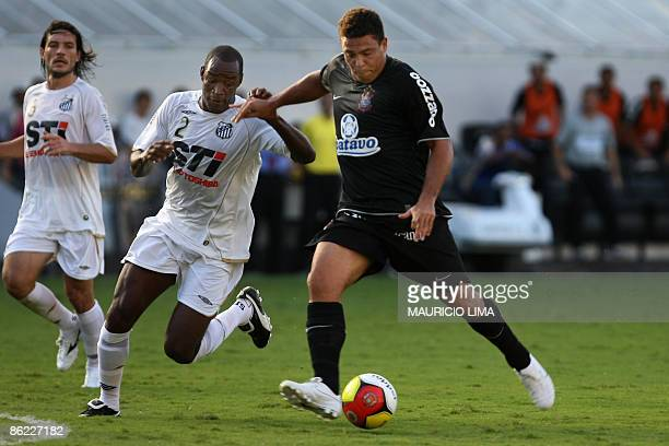 Brazilian striker Ronaldo , of Corinthians, gets ready to score a goal, the second against Santos' Fabao and Germano , during their 2009 Paulista...