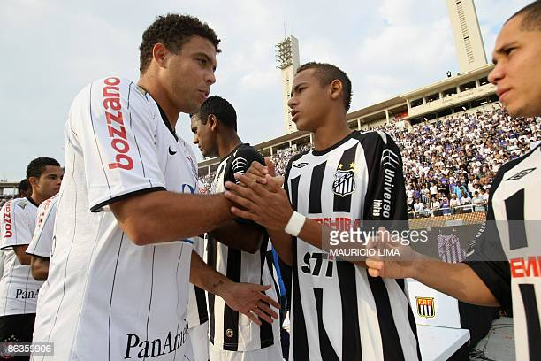 Brazilian striker Ronaldo of Corinthians greets Neymar of Santos before the 2009 Paulista Championship football second leg derby final match against...