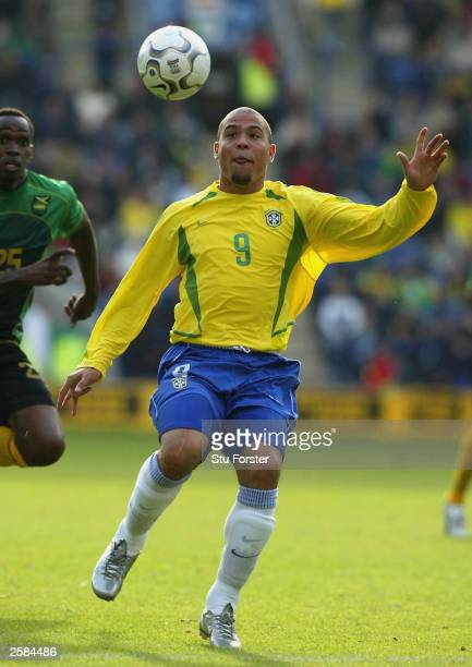 Brazilian striker Ronaldo takes on the Jamaican defence during the friendly match between Brazil and Jamaica at The Walkers Stadium on October 12...