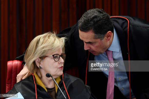 Brazilian Superior Electoral Court's Judge Luis Roberto Barroso talks to the Court's President Judge Rosa Weber during the court trial on the...