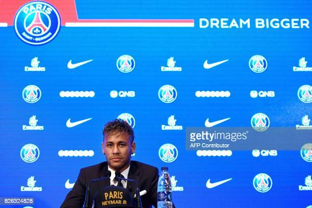 Brazilian superstar Neymar listens during a press conference at the Parc des Princes stadium on August 4 2017 in Paris after agreeing a fiveyear...
