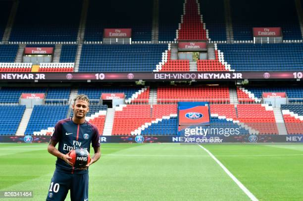 TOPSHOT Brazilian superstar Neymar poses with a ball during his official presentation at the Parc des Princes stadium on August 4 2017 in Paris after...