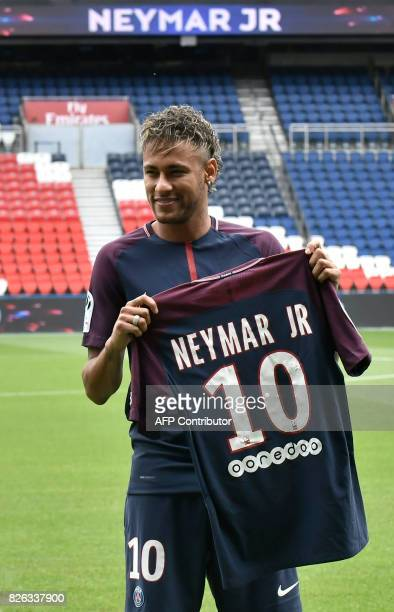 Brazilian superstar Neymar poses with his new jersey during his official presentation at the Parc des Princes stadium on August 4, 2017 in Paris...
