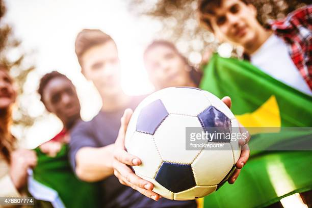 Brazilian supporter with soccer ball