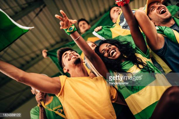 brazilian supporters have fun at the stadium - international match stock pictures, royalty-free photos & images