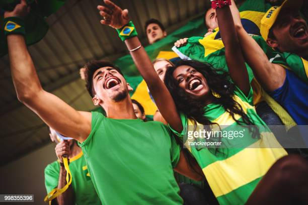 brazilian supporters have fun at the stadium