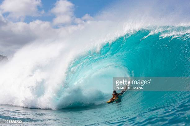 TOPSHOT Brazilian surfer Guilherme Tamega rides a wave at Banzai Pipeline Oahu Hawaii on December 31 2019 / RESTRICTED TO EDITORIAL USE / The...