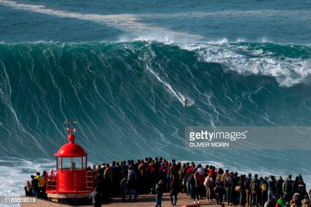 Brazilian surfer Rodrigo Koxa rides a wave during a free surfing session in Nazare, on November 20 waves reached between 15 and 20mt high. - Nazare...
