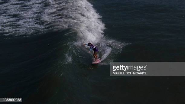 Brazilian surfist Malu Mendes, who has cerebral palsy and is the Para Surfing World Champion in 2020, rides a wave during a training in the Adapted...