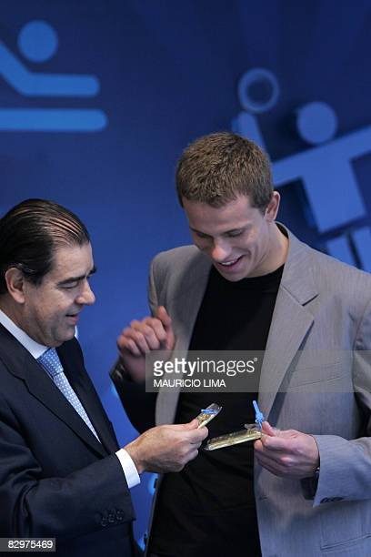 Brazilian swimmer Cesar Cielo Filho receives two gold bars from the former chairman of the Mercantile & Futures Exchange , Manoel Felix Cintra Neto ,...