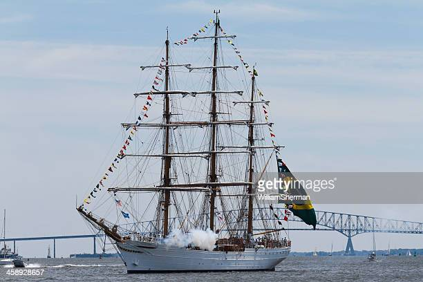brazilian tall ship cisne branco firing cannon - fort mchenry stock photos and pictures