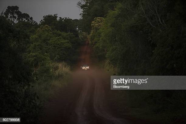Brazilian Tax Authority agents drive down a dirt road often used by smugglers near the border with Paraguay in Foz do Iguacu Brazil on Wednesday Oct...