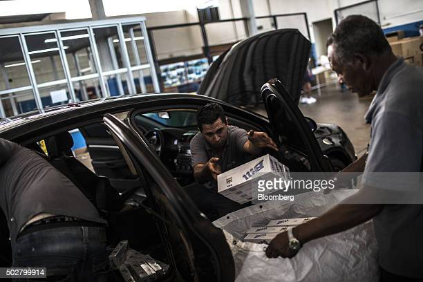 Brazilian Tax Authority workers remove smuggled cigarettes from a seized vehicle near the border with Paraguay in Foz do Iguacu Brazil on Thursday...