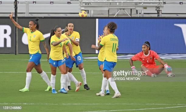 Brazilian team captain Marta celebrates with temmates after scoring a first half goal by Debinha on a penalty kick during their game against...