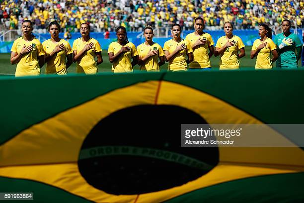 Brazilian team line up for their national anthem before the Women's Olympic Football Bronze Medal match between Brazil and Canada at Arena...