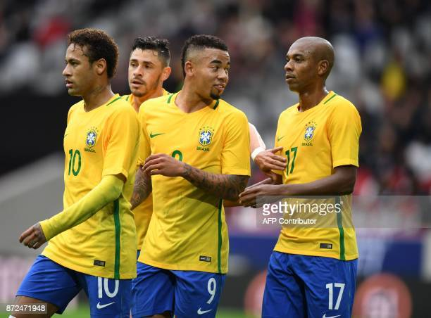 Brazilian team members celebrate after scoring a goal during Japan's friendly football match against Brazil on November 10, 2017 at the Pierre Mauroy...