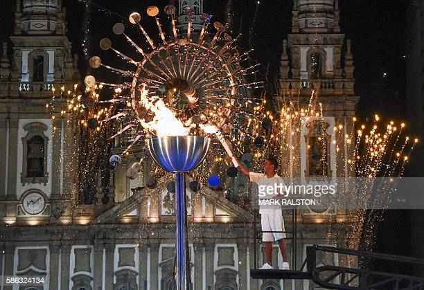 Brazilian teen athlete Jorge Alberto Gomes lights the cauldron at Candelaria Church with the Olympic torch following the opening ceremony of the Rio...