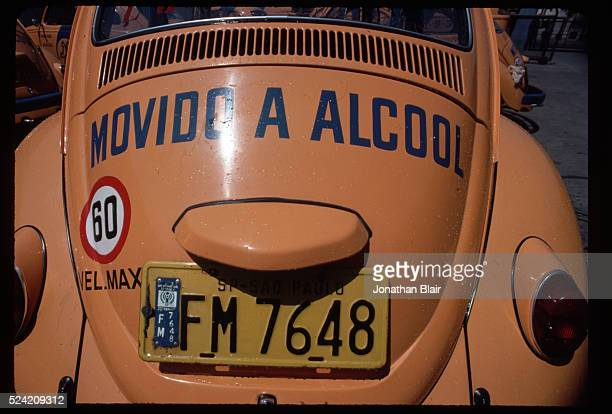 A Brazilian telephone company's fleet Volkswagen Beetle runs on alcohol an alternative to gasoline made from sugarcane plants