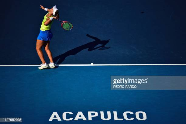 TOPSHOT Brazilian tennis player Beatriz Haddad Maia serves the ball to US tennis player Sloane Stephens during a WTA Mexico Open singles match in...