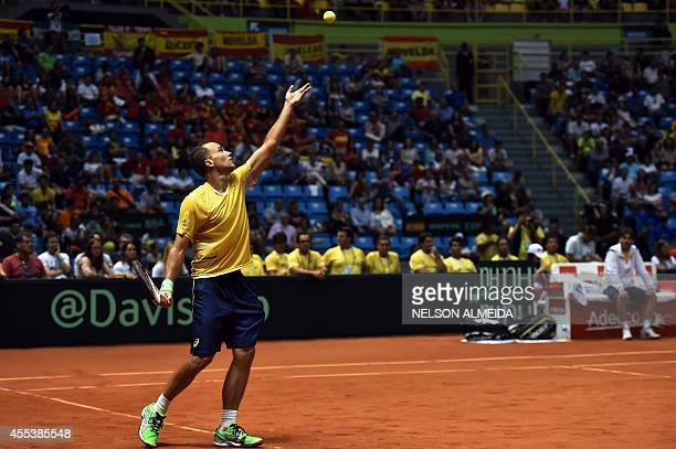 Brazilian tennis player Bruno Soares serves during the Davis Cup World Group playoff doubles tennis match against Spanish Marc Lopez and David...