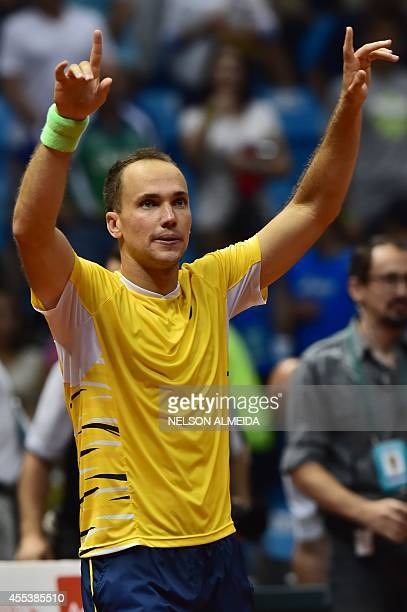 Brazilian tennis player Bruno Soares waves to the crowd after defeating Spanish Marc Lopez and David Marrero with teammate Marcelo Melo in their...