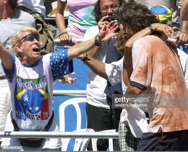 Brazilian tennis player Fernando Meligeni celebrates with his family after defeating French Cedric Pioline in Florianopolis Brazil 04 February 2000...