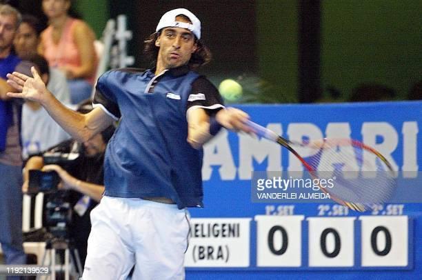 Brazilian tennis player Fernando Meligeni hits the ball in Rio de Janeiro Brazil 05 January 2001 El brasileno Fernando Meligeni devuelve la pelota...