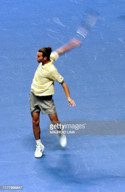 Brazilian tennis player Gustavo Kuerten present leader of ATP returns a ball to Argentine player Franco Squilarri during a game of Desafio...