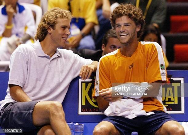Brazilian tennis player Gustavo Kuerten smiles and sits next to his coach Jayme Oncins in Rio de Janeiro Brazil03 January 2002 El brasileno Gustavo...