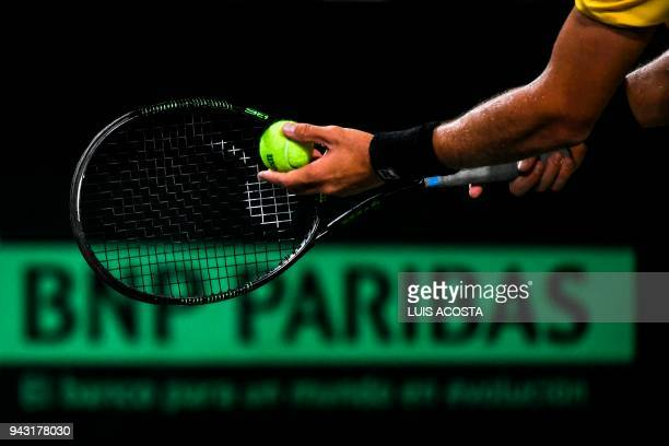Brazilian tennis player Joao Sorgi serves against Colombian tennis player Alejandro Gonzalez during their Americas Zone Group I 2nd round Davis Cup...