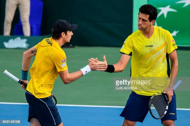 Brazilian tennis player Marcelo Demoliner celebrates with his teammate Marcelo Melo after winning a point against Colombian tennis players Juan...