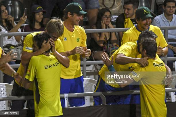 Brazilian tennis player Marcelo Melo and Marcelo Demoliner celebrate with their teammates after defeating Colombian tennis players Juan Sebastian...