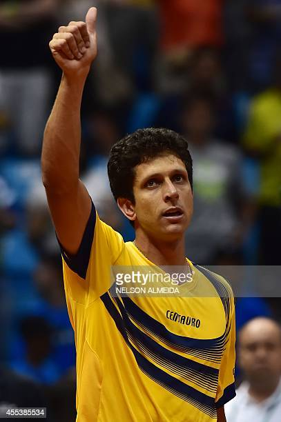 Brazilian tennis player Marcelo Melo celebrates after defeating Spanish Marc Lopez and David Marrero with teammate Bruno Soares in their Davis Cup...