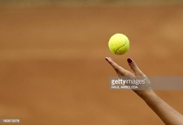 Brazilian tennis player Paula Goncalves serves to Montserrat Gonzalez of Paraguay during their International Tennis Federation Fed Cup Americas Zone...