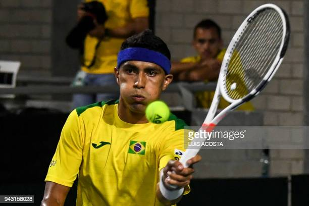 Brazilian tennis player Thiago Monteiro returns the ball to Colombian tennis player Daniel Galan during their Americas Zone Group I 2nd round Davis...