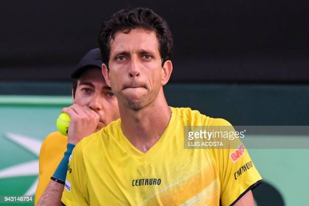 Brazilian tennis players Marcelo Melo and Marcelo Demoliner gesture during Americas Zone Group I 2nd round Davis Cup tennis doubles match against...