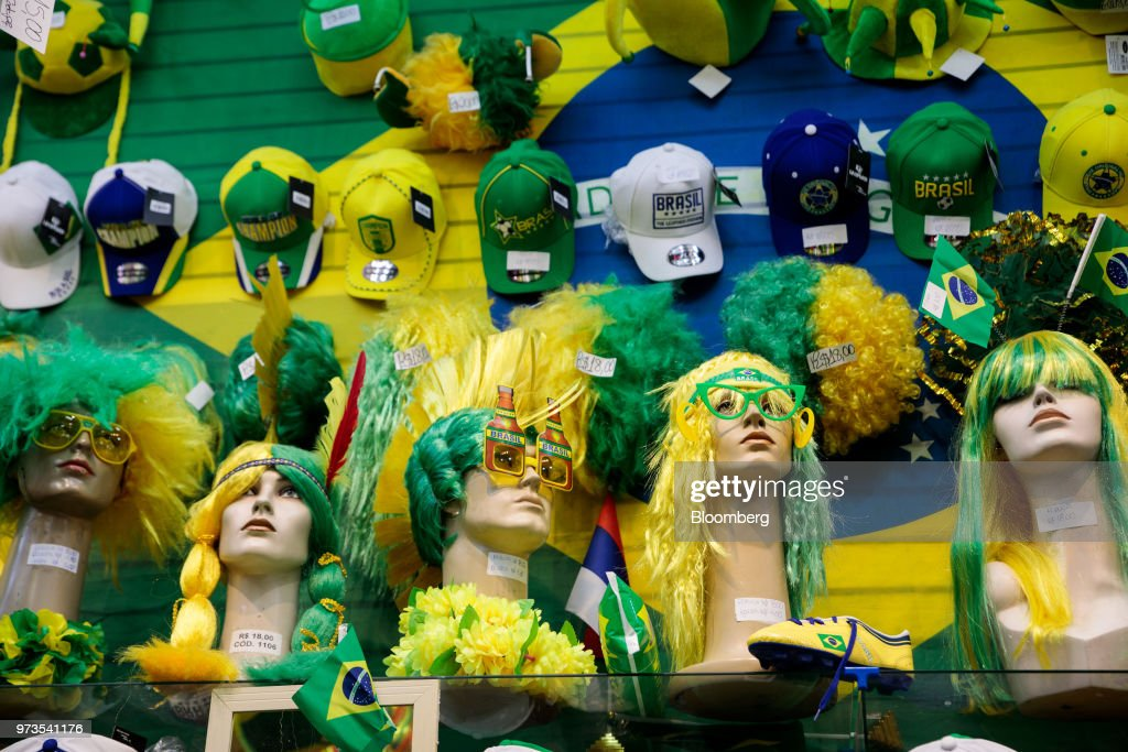 Brazilian themed merchandise is displayed for sale at a store ahead of the FIFA World Cup games in downtown Sao Paulo, Brazil, on Wednesday, June 13, 2018. In a curious quirk of Brazil's electoral calendar, for the last 28 years Latin America's largest economy has gone to the polls shortly after the World Cup. In the football-obsessed country, politicians have long attempted to hijack the sport to burnish their image. Photographer: Patricia Monteiro/Bloomberg via Getty Images