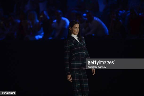 Brazilian top model Adriana Lima walks the runway during the Dosso Dossi Fashion Show in Antalya, Turkey on June 09, 2017.