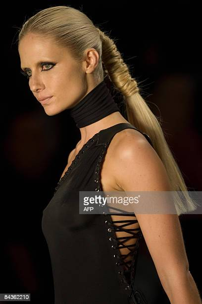 Brazilian top model Ana Claudia Michels presents a creation by Forum Tufi Duek during the opening day of the 2009 AutumnWinter collections of the Sao...
