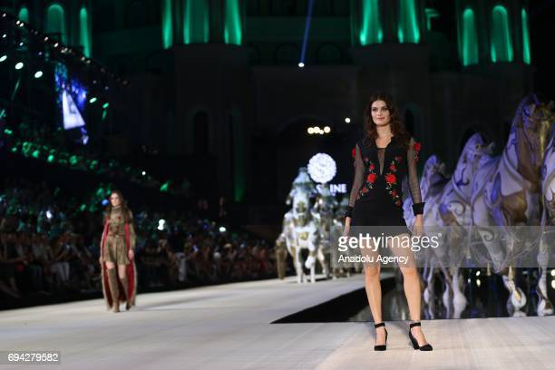 Brazilian top model Isabeli Fontana walks the runway during the Dosso Dossi Fashion Show in Antalya, Turkey on June 09, 2017.