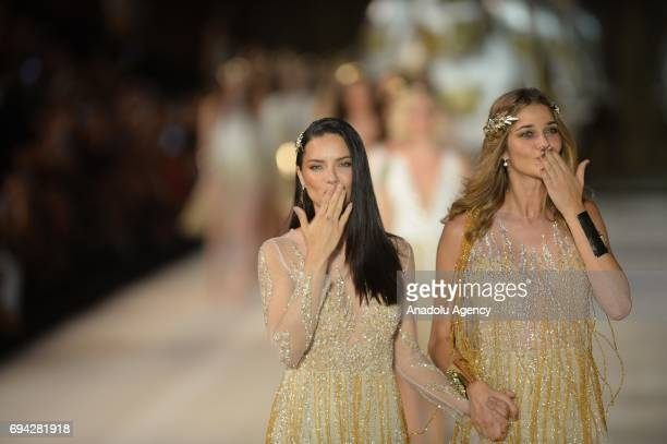 Brazilian top models Adriana Lima and Ana Beatriz Barros salute the people as they walk the runway during the Dosso Dossi Fashion Show in Antalya,...