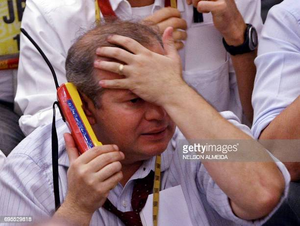A Brazilian trader looks upset as he negotiates during the afternoon session at the Mercantile Futures Exchange in Sao Paulo Brazil on September 17...