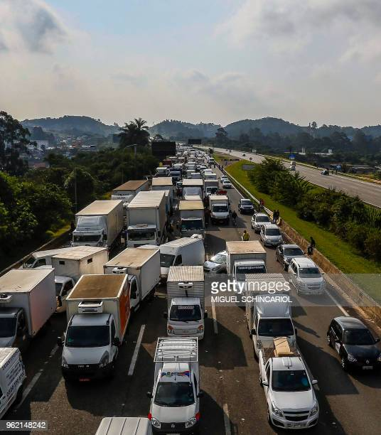 Brazilian truck drivers block the Imigrantes road, 23 kilometres from Sao Paulo, during the fourth day of strike to protest rising fuel costs in...